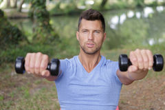 Male sports model exercising outside as part healthy lifestyle. Male sports model exercising outside as part of healthy lifestyle Royalty Free Stock Images