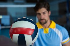 Male sportsperson holding volleyball Royalty Free Stock Photography