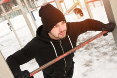 Male sporty adult doing push up exercise outdoors. Young healthy man working out. Winter fitness workout Stock Photo