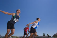 Male sprinters on track, low angle view Royalty Free Stock Image