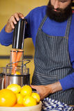 Male staff preparing juice at organic section. In supermarket Royalty Free Stock Photos