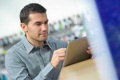 Male staff using digital tablet. Male staff using a digital tablet Stock Photos