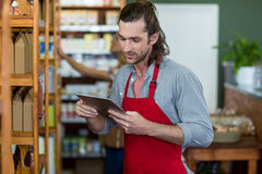 Male staff using a digital tablet. In supermarket Royalty Free Stock Photo