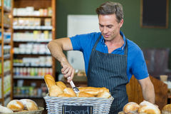 Male staff working at bakery store. In supermarket Royalty Free Stock Images