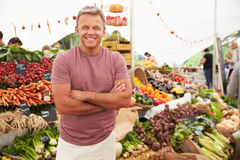 Male Stall Holder At Farmers Fresh Food Market Stock Images