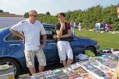Male Stall Holders. This photo shows a couple of stall holders hoping for more sales at the bootfair organised annually by the community college in Whitstable Stock Photography