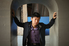 Male standing in archway Stock Photo