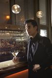 Male standing at bar. Royalty Free Stock Photography