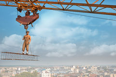 Male standing on construction on high. Stock Image