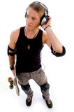 Male standing with skate board Stock Photo