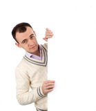 Male standing by white blank card Stock Photos