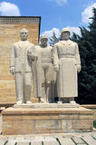 Male Statue Group. In front of the Freedom Tower there is a statue group made up of three men. The man at the right with a helmet and coat represents a Turkish Royalty Free Stock Image