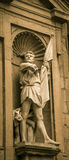 Male statue holding a flag. A male statue holding flag in florence italy Royalty Free Stock Photo
