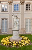 Male statue in Lazienki Palace (1795) in Warsaw, Poland. Marble sculpture of naked man in front of Lazienki Palace (Palace on the Water, circa 1795) in Royal Royalty Free Stock Image