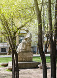 Male statue monument of writer in Bucharest park Stock Photo