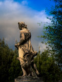 Male statue park in florence. Male robed statue in a park in Florence Italy Royalty Free Stock Photo