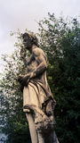 Male statue park in florence. Male robed statue in a park in Florence Italy Stock Photography
