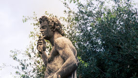 Male statue park in florence. Male robed statue in a park in Florence Italy Stock Image