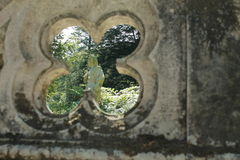 Male statue in the gardens of Quinta da Regaleira. Statue of mythical god Hermes in the beautiful gardens of Quinta de Regaleira, one of UNESCO world heritage Royalty Free Stock Photography