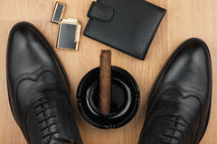 Male still life, classic men's shoes and a cigar in an ashtray. Can use as background Stock Photos