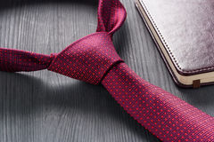 Male still life. A fountain pen with a notebook lies on a tie. Stock Image