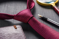 Male still life. A fountain pen with a notebook lies on a tie. Royalty Free Stock Photo