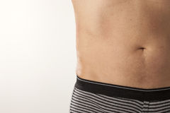 Male Stomach. The waist and stomach of a man wearing underwear Royalty Free Stock Images