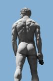 Male stone sculpture. Seen in Florence (Italy)  from behind in sunny ambiance Stock Photography