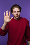 Male with stop hand gesture. Protest emotion. Young man swearing oath, freedom advertising stock photo