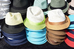 Male straw caps. Exposition of male hats in a local market Royalty Free Stock Image