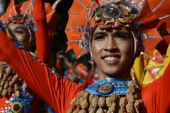 Male Street dancer in colorful coconut costume dance on the street. SAN PABLO CITY, LAGUNA, PHILIPPINES - JANUARY 13, 2017 Male Street dancer in colorful coconut Royalty Free Stock Photos