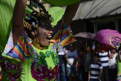 Male Street dancer in colorful coconut costume dance on the street. SAN PABLO CITY, LAGUNA, PHILIPPINES - JANUARY 13, 2017 Male Street dancer in colorful coconut Stock Photography