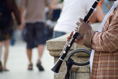Male street musician playing clarinet Royalty Free Stock Photo