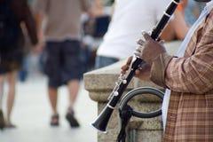 Male street musician playing clarinet. Hamburg, Germany – 31. July 2009: male street musician playing clarinet Royalty Free Stock Photo