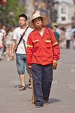 Male street sweeper, Beijing, China. BEIJING-JUNE 9, 2015. Male street sweeper walks with a broom. Thanks to an army of street sweepers the Beijing city center Royalty Free Stock Image