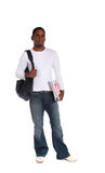 Male student. An attractive dark-skinned student standing in front of a plain white background Royalty Free Stock Image