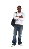 Male student. An attractive dark-skinned student standing in front of a plain white background Royalty Free Stock Photo
