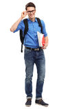 Male student. Young man over white background Royalty Free Stock Image