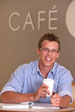 Male Student. Portrait of male student taking a coffee break Royalty Free Stock Images