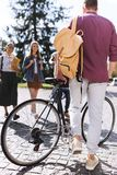 Male student with bicycle. Group of happy male student with bicycle going to his friends Stock Image