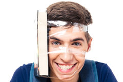 Male student with book strapped to his head Stock Photos