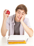 Male student with books and apple Royalty Free Stock Image