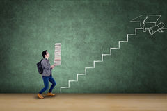 Male student with books and staircase Royalty Free Stock Photos