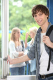 Male student on campus. Male student walking to his next lesson Stock Photo
