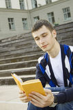 Male student on campus with textbooks Stock Images