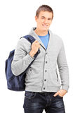 Male student carrying a backpack. Isolated on white background Royalty Free Stock Photos