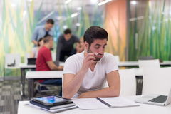 Male student in classroom Stock Photo