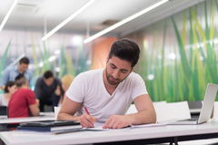 Male student in classroom Stock Image