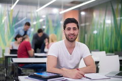 Male student in classroom Royalty Free Stock Photos