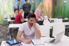 Male student in classroom Stock Photography